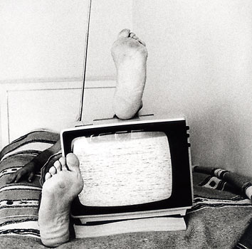 Me as a model with my feet on top of a TV. Cd cover (front page)